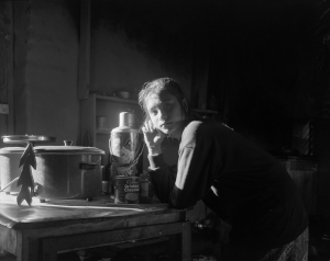 Girl in Dark Kitchen